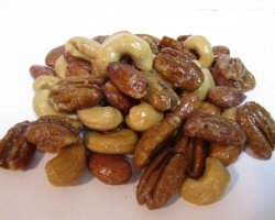 A pile of glazed nuts from the side